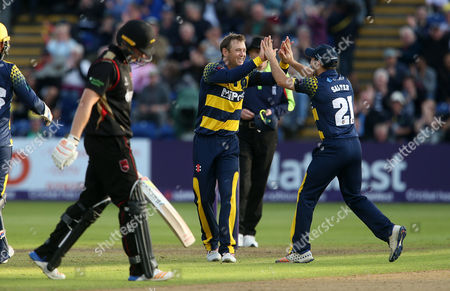 Colin Ingram of Glamorgan celebrates with Andrew Salter after bowling and catching Tom Wells of Leicestershire.