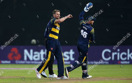 Michael Hogan of Glamorgan celebrates after Aneurin Donald catches Clint McKay of Leicestershire.