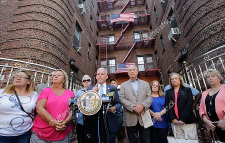 """New York City Councilman Jimmy Van Bramer speaks at a news conference in front of an apartment building where Nazi symbols have been posted in the lobby, in the Queens borough of New York. """"This lobby represents one giant hate crime,"""" said the councilman. He added, """"It is not simply someone who has bad taste in decorating lobbies. This is illegal"""