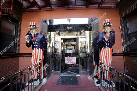 Two statues of Uncle Sam frame the entrance to an apartment building, in the Queens borough of New York. In addition to patriotic images, the building's property manager has placed racist and anti-semitic images in the lobby, according to New York City Councilman Jimmy Van Bramer