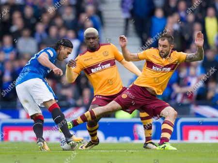 Carlos Pena of Rangers tries ot beat Cedric Kipre & Peter Hartley of Motherwell during the Betfred Cup Semi-Final between Rangers & Motherwell at Hampden Park, Glasgow on 22nd October 2017