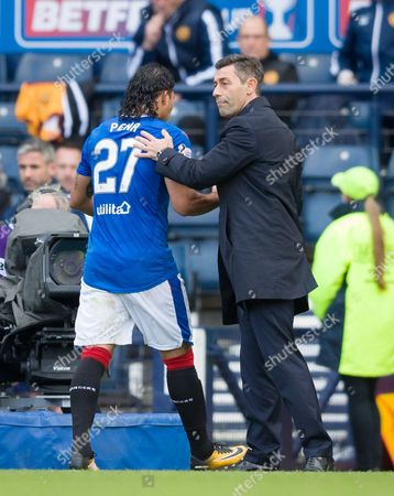 Carlos Pena of Rangers gets a pat from Rangers Manager Pedro Caixinha as he is substituted during the Betfred Cup Semi-Final between Rangers & Motherwell at Hampden Park, Glasgow on 22nd October 2017