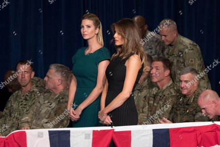Stock Image of Melania Trump, Ivanka Trump Ivanka Trump, the daughter of President Donald Trump, and first lady Melania Trump stand together before President Donald Trump arrives to speak at Fort Myer in Arlington Va., during a Presidential Address to the Nation about a strategy he believes will best position the U.S. to eventually declare victory in Afghanistan