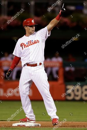 Philadelphia Phillies' Rhys Hoskins reacts after hitting a two-run double off Miami Marlins relief pitcher Brian Ellington during the seventh inning of a baseball game, in Philadelphia. Philadelphia won 8-0
