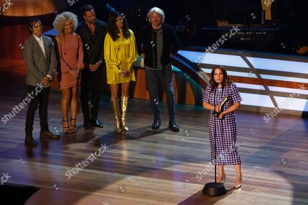 Lori McKenna accepts her Songwriter of the Year award as Little Big Town looks on during the 11th annual ACM Honors at the Ryman Auditorium, in Nashville, Tenn