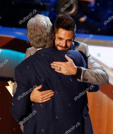 Stock Image of Thomas Rhett hugs Mae Boren Axton Service Award winner Bob Kingsley during the 11th annual ACM Honors at the Ryman Auditorium, in Nashville, Tenn