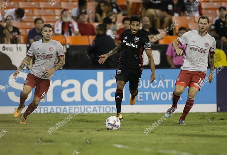 Stock Photo of D.C. United Defender #5 Sean Franklin looks to pass the ball into the center during an MLS soccer match between the D.C. United and the Atlanta United FC at RFK Stadium in Washington DC