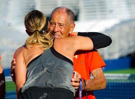 Nick Bollettieri hugs Maria Sharapova during practice at the 2017 US Open Grand Slam tennis tournament