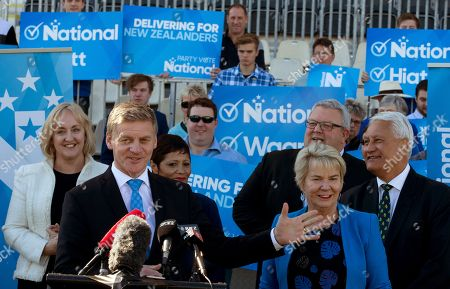 New Zealand Prime Minister Bill English, front left, stands with colleagues and supporters as he makes an announcement on funding for a new multi-sport stadium in Christchurch, New Zealand, . New Zealand will hold a general election on Saturday, Sept. 23, 2017