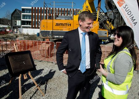 New Zealand Prime Minister Bill English, left, talks with a worker at a construction site in Christchurch, New Zealand, . New Zealand will hold a general election on Saturday, Sept. 23, 2017