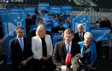 New Zealand Prime Minister Bill English, foreground, stands with colleagues and supporters as he makes an announcement on funding for a new multi-sport stadium in Christchurch, New Zealand, . New Zealand will hold a general election on Saturday, Sept. 23, 2017