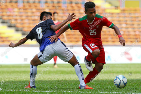 Osvaldo Ardiles Haay, Hoy Phallin Indonesia's Osvaldo Ardiles Haay, right, manages to get past Cambodia's Hoy Phallin in a soccer match at the South East Asian Games in Shah Alam, Malaysia