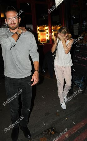 Stock Picture of Jacobi Anstruther-Gough-Calthorpe and Cressida Bonas leaving the Old Red Lion Theatre in Islington where she is starring in 'Mrs Orwell' play
