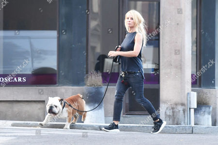 Helena Seger walking her dog