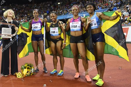 Stock Image of Jamaica's (2-L to R) Elaine Thompson, Jura Levy, Christania Williams, and Simone Facey celebrate next to Zurich mayor Corinne Mauch (L) after winning the women's  4x100m Relay during the Weltklasse IAAF Diamond League international athletics meeting in the Letzigrund stadium in Zurich, Switzerland, 24 August 2017.