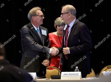 Stock Picture of Jeff Kent, John Hammond, Susie Hudson Chairman Jeff Kent, left, shakes hands with vice-chairman John Hammond, right, after a session of the standing committee on rules at the Republican National Committee summer meeting, in Nashville, Tenn. At center is secretary Susie Hudson