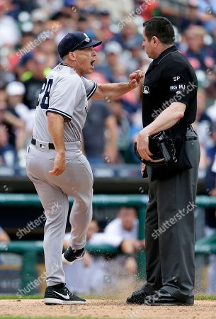 Joe Girardi, Carlos Torres New York Yankees manager Joe Girardi kicks the dirt while arguing with home plate umpire Carlos Torres after Yankees pitcher Tommy Kahnle was ejected during the sixth inning of a baseball game against the Detroit Tigers, in Detroit. Torres ejected Girardi moments later