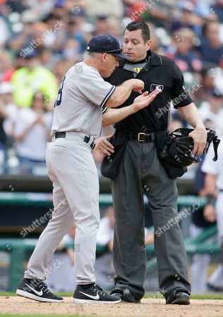 Joe Girardi, Carlos Torres New York Yankees manager Joe Girardi argues with home plate umpire Carlos Torres after Yankees pitcher Tommy Kahnle was ejected during the sixth inning of a baseball game against the Detroit Tigers, in Detroit. Torres ejected Girardi moments later