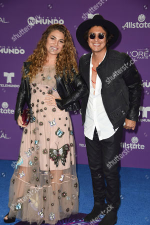Periko and Jessi Leon attend the 2017 Premios Tu Mundo at the American Airlines Arena on in Miami