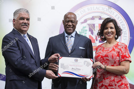 Dominican singer Johnny Ventura (C), Vice President Margarita Cedeno (R) and Foreign Relations Minister Miguel Vargas (L) pose for a photo during the 'Merengue, Music and Dance for the World' ceremony at the Dominican Foreign Ministry in Santo Domingo, Dominican Republic, 24 August 2017. The Dominican dance Merengue received recognition from the United Nations Educational, Scientific and Cultural Organization (UNESCO) as an Intangible Cultural Heritage of Humanity.