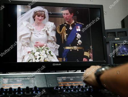 Stock Photo of A 35mm film of the wedding of Britain's Prince Charles and Lady Diana Spencer is colour graded by Gerry Gedge after it has been digitised, at R3store lab in London, . Thirty-six years after Lady Diana Spencer married Prince Charles, The Associated Press has restored original footage from the wedding and is making it available to the public on YouTube. The 25 minutes of footage comes from the archive of British Movietone, which AP acquired in 2016