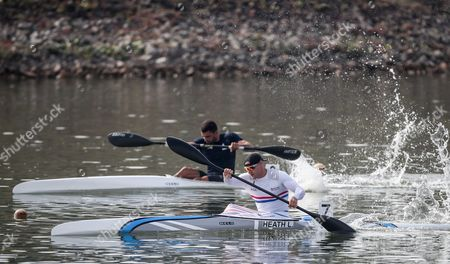 Liam Heath of Great Britain (front) competes in a heat of the K1 men 200m event at the ICF Canoe Sprint World Championships in Racice, Czech Republic, 25 August 2017.