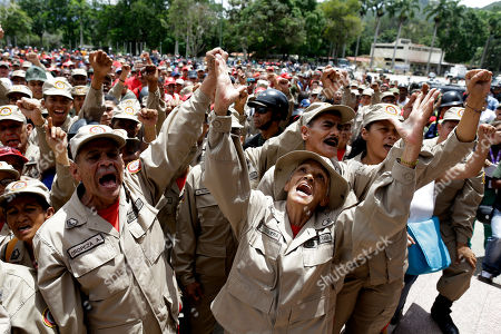 Militia members shouts slogans during a speech by the commander of the Venezuelan Bolivarian Militia, Gen. Carlos Leal Telleria, in Fort Tiuna, Caracas, Venezuela, . President Nicolas Maduro ordered military exercises in response to U.S. President Donald Trump's warning of possible military action to resolve the country's crisis