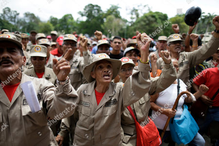 Militia members shouts slogans during a speech by the commander of the Venezuelan Bolivarian Militia, Gen. Carlos Leal Telleria, in Fort Tiuna, Caracas, Venezuela, . President Nicolas Maduro ordered military exercises in response to President Donald Trump's warning of possible military action to resolve the country's crisis