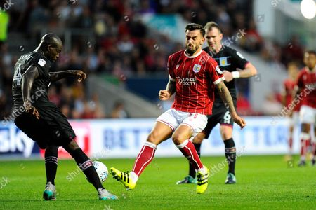 Marlon Pack (21) of Bristol City is tackled by Christopher Samba (4) of Aston Villa during the EFL Sky Bet Championship match between Bristol City and Aston Villa at Ashton Gate, Bristol