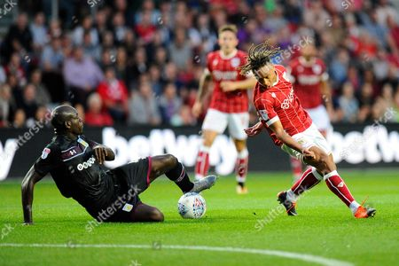 Christopher Samba (4) of Aston Villa slides in to take the ball off Bobby Reid (14) of Bristol City during the EFL Sky Bet Championship match between Bristol City and Aston Villa at Ashton Gate, Bristol