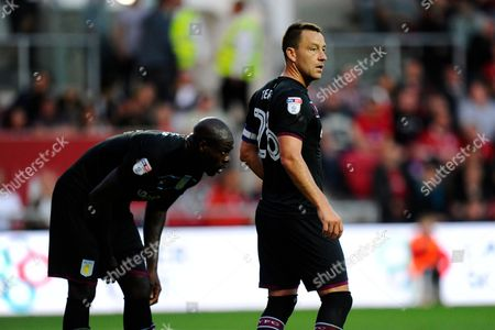 Christopher Samba (4) of Aston Villa and John Terry (26) of Aston Villa during the EFL Sky Bet Championship match between Bristol City and Aston Villa at Ashton Gate, Bristol
