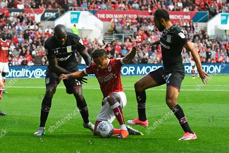 Bobby Reid (14) of Bristol City battles for possession with Christopher Samba (4) of Aston Villa and Ahmed Elmohamady (27) of Aston Villa during the EFL Sky Bet Championship match between Bristol City and Aston Villa at Ashton Gate, Bristol