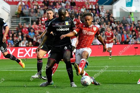 Christopher Samba (4) of Aston Villa closes down the attack of Bobby Reid (14) of Bristol City during the EFL Sky Bet Championship match between Bristol City and Aston Villa at Ashton Gate, Bristol