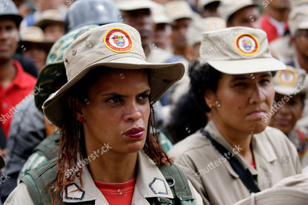 Militia members listen to Gen. Carlos Leal Telleria, Commander of the Venezuelan Bolivarian Militia, in Fort Tiuna, Caracas, Venezuela, . President Nicolas Maduro ordered military exercises in response to President Donald Trump's warning of possible military action to resolve the country's crisis