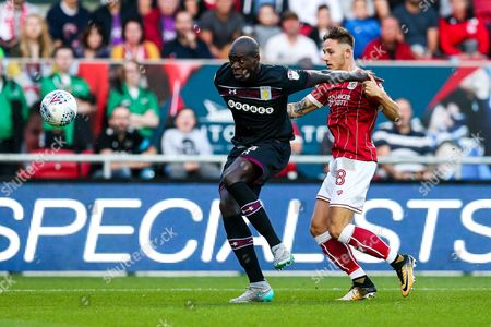 Christopher Samba of Aston Villa is challenged by Josh Brownhill of Bristol City
