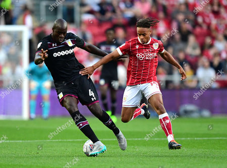 Bobby Reid of Bristol City challenges for the ball with  Christopher Samba of Aston Villa