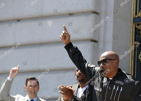 Musician MC Hammer speaks at a rally in San Francisco, ahead of politically conservative rallies scheduled this weekend. Despite worries about violence at the upcoming free-speech rallies, some people plan to welcome their political opponents with unusual protests: a field of dog poop, red-nosed clowns and a giant inflatable chicken that bears the hairstyle of President Donald Trump