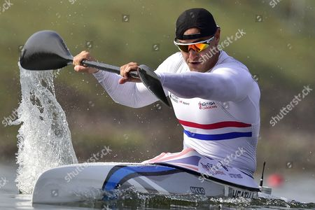 Liam Heath of Great Britain competes in a preliminary heat of the Men's K1 200m race at the ICF Canoe Sprint World Championships in Racice, Czech Republic, 25 August 2017.