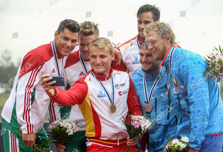 (L-R) Second placed Bence Nadas and Sandor Totka of Hungary, first placed Rodrigo Germande and Marcus Cooper Walz of Spain and third placed Vitaly Bialko and Raman Piatrushenka of Bulgaria pose for selfie on the podium during the medal ceremony for the K2 men 500m race of the ICF Canoe Sprint World Championships in Racice, Czech Republic, 26 August 2017.