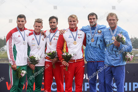 (L-R) Second placed Bence Nadas and Sandor Totka of Hungary, first placed Rodrigo Germande and Marcus Cooper Walz of Spain and third placed Vitaly Bialko and Raman Piatrushenka of Bulgaria pose on the podium during the medal ceremony for the K2 men 500m race of the ICF Canoe Sprint World Championships in Racice, Czech Republic, 26 August 2017.