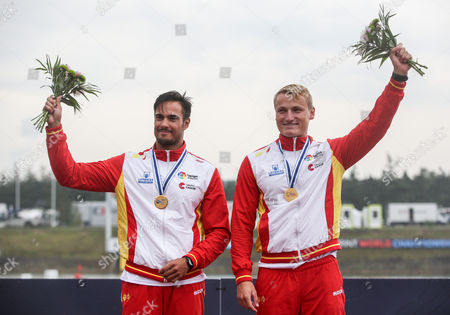 Stock Photo of First placed Rodrigo Germande (R) and Marcus Cooper Walz of Spain react on the podium during the medal ceremony for the K2 men 500m race of the ICF Canoe Sprint World Championships in Racice, Czech Republic, 26 August 2017.