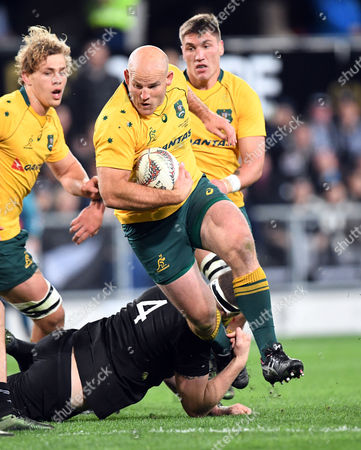 Stephen Moore of Australia breaks the tackle of Brodie Retallick of New Zealand in the Investic Rugby Championship test match between the New Zealand and Australia at Forsyth Barr Stadium, Dunedin, New Zealand, August 26, 2017.