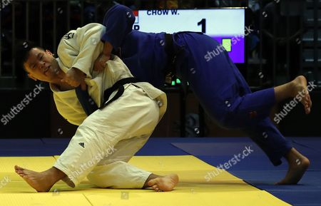Chow Weng Luen Gary (white) of Singapore and Kohagura Kohei (blue) of Philippines compete during the men's -81kg judo event during the SEA Games 2017 events in Kuala Lumpur, Malaysia, 27 August 2017.