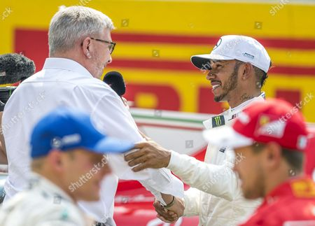 British Formula One driver Lewis Hamilton of Mercedes AMG GP receives greetings from Ross Brawn (L) Formula One managing Director of motor sports after he took pole position in the qualifying session for the 2017 Belgium Formula One Grand Prix at the Spa-Francorchamps race track near Francorchamps, Belgium, 26 August 2017. The 2017 Belgium Formula One Grand Prix will take place on 27 August.
