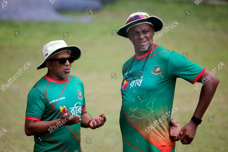 Stock Picture of Bangladesh head coach Chandika Hathurusingha, left, and bowling coach Courtney Walsh talk during a practice session a day ahead of their first cricket test match against Australia in Dhaka, Bangladesh