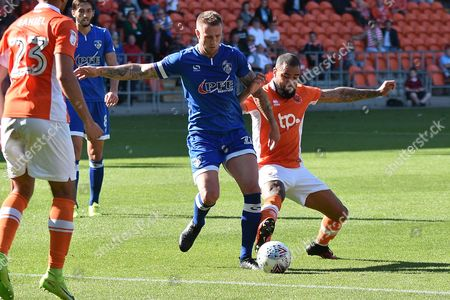 Oldham Athletic Defender, Peter Clarke (26) and Blackpool Forward, Kyle Vassell (7) goal scorer during the EFL Sky Bet League 1 match between Blackpool and Oldham Athletic at Bloomfield Road, Blackpool
