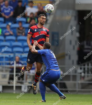 Stock Image of Steven Caulker of QPR wins a header against Kenneth Zohore of Cardiff City
