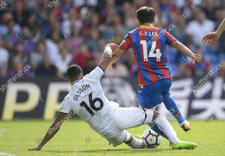 Martin Olsson of Swansea City tackles Chung-Yong Lee of Crystal Palace