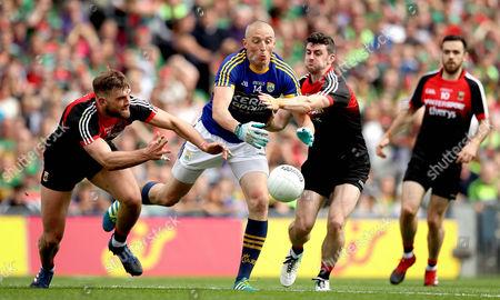 Mayo vs Kerry. Mayo's Aidan O?Shea and Brendan Harrison with Kieran Donaghy of Kerry