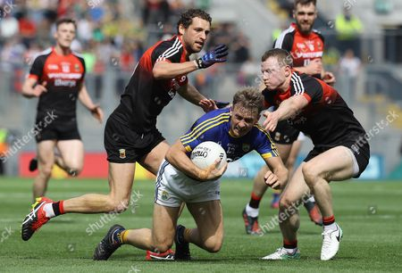 Mayo vs Kerry. Mayo's Tom Parsons and Colm Boyle tackle Donnchadh Walsh of Kerry